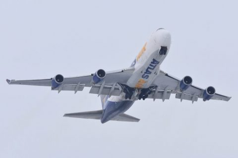 Photo of an Atlas Air plane in flight, taken from the ground