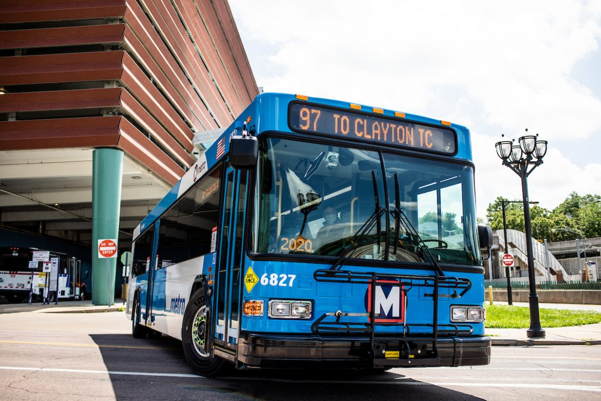 A MetroBus pulls out of the Clayton transit center. The operator can be seen through the windshield.