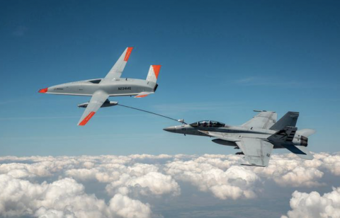 An unmanned MQ-25 aircraft, left, delivers fuel to an U.S. Navy F/A-18 Super Hornet jet fighter in June during an aerial test that originated at MidAmerica St. Louis Airport in Mascoutah.